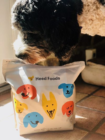 Dog Sniffing Heed Foods Package - Heed Foods Premium Dry Dog Food Review - MealFinds