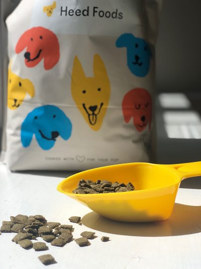 heed-foods-bag-kibble with scoop and kibble spilling out- Heed Foods Premium Dry Dog Food Review - MealFinds