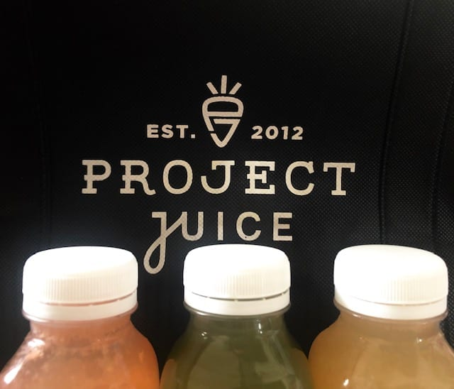 project juice logo with 3 juice bottles in front-project juice juice cleanse review-mealfinds