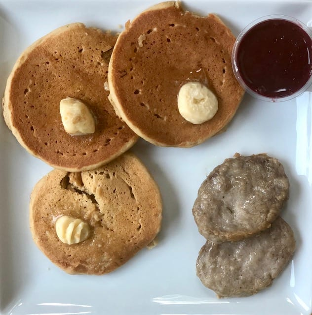 pancakes and sauage on plate with butter-factor healthy prepared meals reviews - mealfinds
