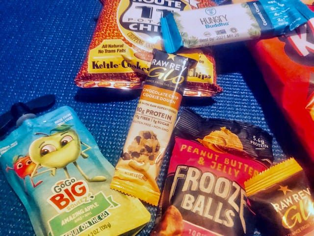 frooze balls and vegan snacks in pile- vegancuts snack box review-mealfinds
