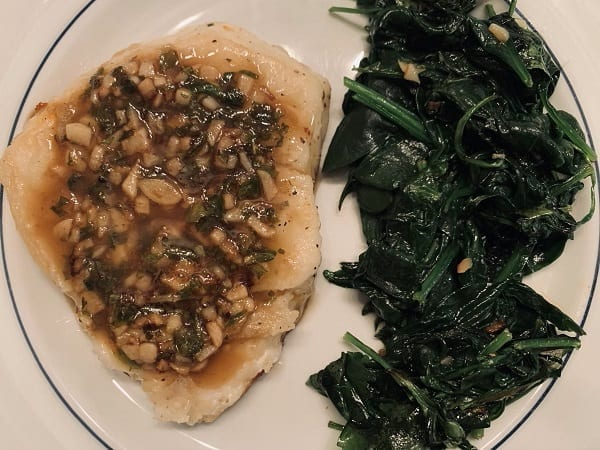 chilean sea bass cooked on plate with spinach-Meat N Bone reviews-mealfinds