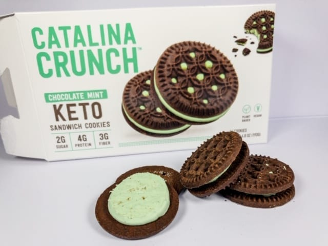 catalina-crunch-mint-keto-cookies on table with box-catalina crunch keto cereal reviews-mealfinds