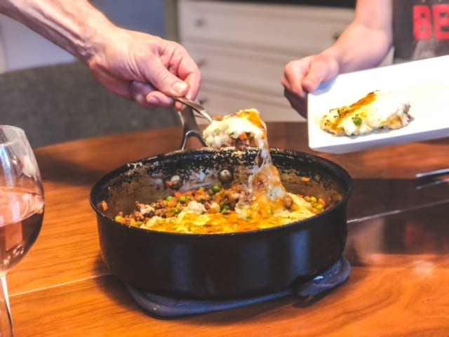 shepards pie in pan being spooned onto plate-green chef reviews-mealfinds