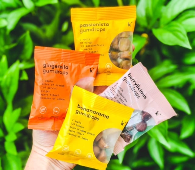kencko-gumdrops-4-flavors being held up outside-kencko Organic Instant Smoothies Reviews-mealfinds