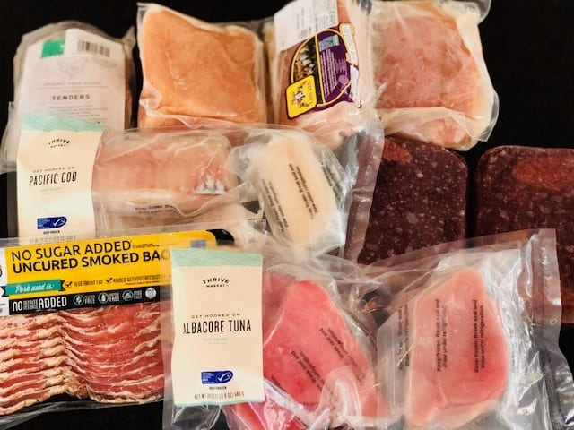 meat and seafood on counter-thrive market reviews-mealfinds