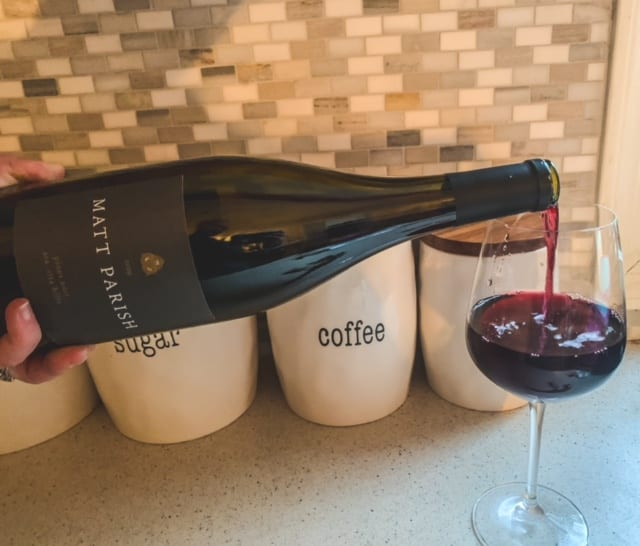 pouring matt parish wine into glass-naked wines reviews-mealfinds