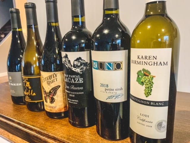 wine bottles lined up-naked wines reviews-mealfinds