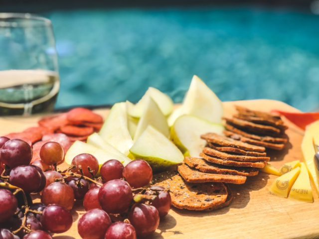 cheese crackers fruit on board near pool-hungry harvest reviews-mealfinds