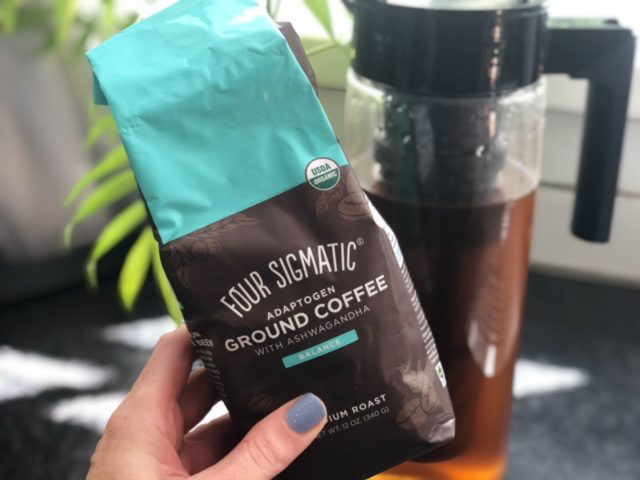 four sigmatic balance ground coffee in front of cold brew-four sigmatic mushroom coffee reviews-mealfinds