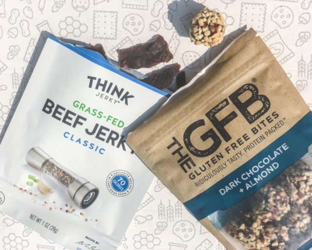 think jerky gfb chocolate almond balls spilling out of packaging-tastecrate review-mealfinds