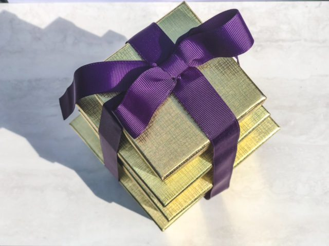 gold gift box tower with purple ribbon-bake me a wish reviews-mealfinds