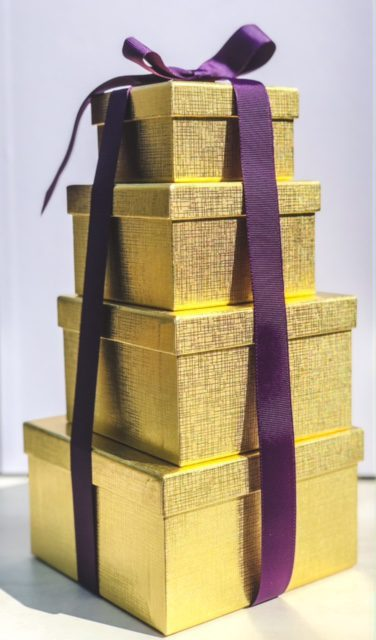 gold boxes stacked with purple ribbon-bake me a wish reviews-mealfinds