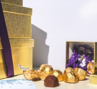 chocolate truffles in gold foil spilling out of gift box-bake me a wish reviews-mealfinds