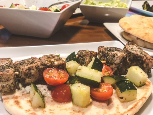 chicken souvlaki with tomato and cucumber on plate--eat2explore cooking kit reviews-mealfinds